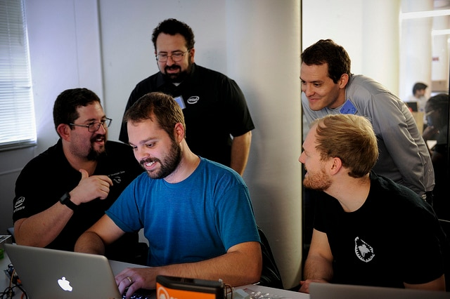 A team of Intel experts helping a hackathon participant