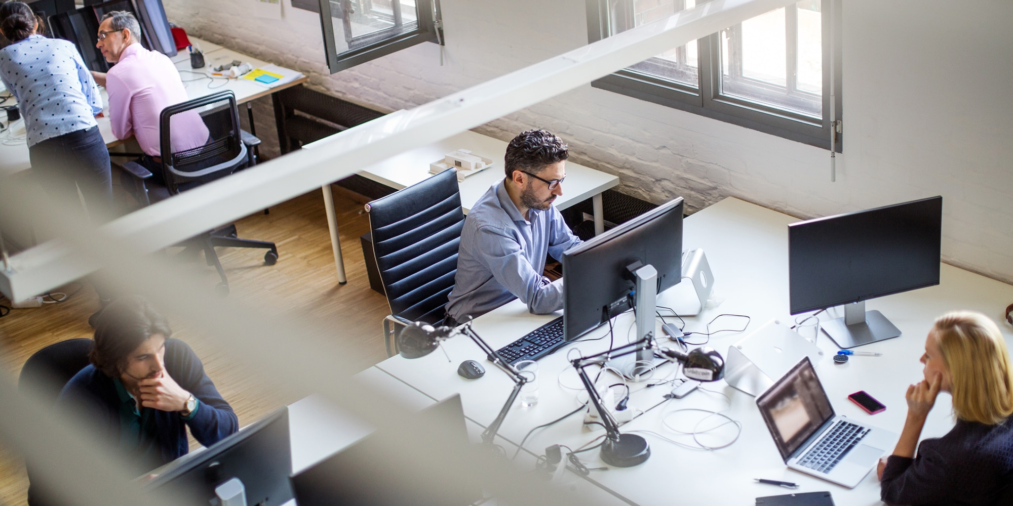 Open office workers in front of computers