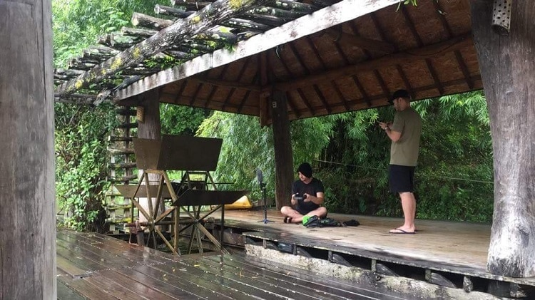 Justin Lassen recording by a Thai river