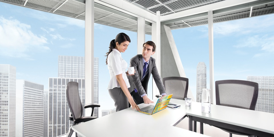 Man and woman in office with Ultrabook
