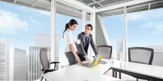 Man and woman in meeting room with ultrabook