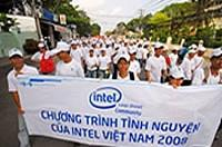 Intel staff in Vietnam march with a white banner