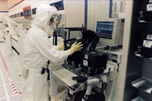Intel technicians monitors wafers