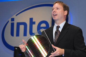 "Kirk Skaugen holds up a ""Lynnfield"" wafer, Intels second-generation desktop Nehalem, during his IDF Taiwan keynote."