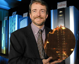 Pat Gelsinger, senior vice president and general manager of the Digital Enterprise Group at Intel Corp., displays a wafer containing the Dual-Core Intel Itanium® 9000 Series Processors, previously codenamed Montecito, at an event in San Francisco, Tuesday, July 18, 2006.